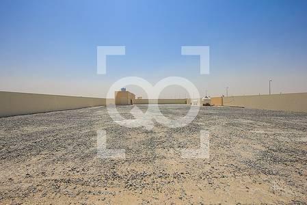 ارض تجارية  للايجار في السجع، الشارقة - Spacious and Well Maintained Gated Open Yard in Al Sajaa Sharjah