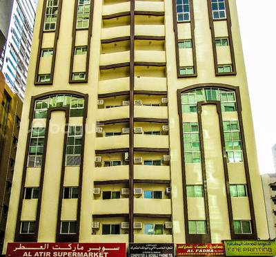 2 Bedroom Apartment for Rent in Al Qasimia, Sharjah - 2 B/R Hall Flat With Balcony & Split Ducted A/C in Al Qasimia area