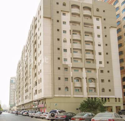 2 Bedroom Flat for Rent in Bu Daniq, Sharjah - Spacious 2 B/R Hall Flat With Split Ducted A/c In Behind Mega mall
