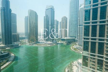 Office for Rent in Jumeirah Lake Towers (JLT), Dubai - Fitted Office on High Floor with Lake View