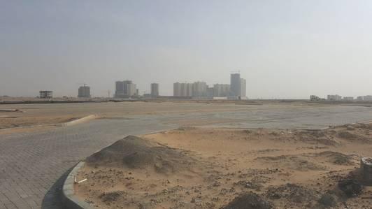 ارض تجارية  للبيع في الرقايب، عجمان - فرصة لن تتكرر بالإمارات للبيع أراضي بالتقسيط سكنى تجارى زاوية بمنطقة العالية بعجمان مساحة 400 متر