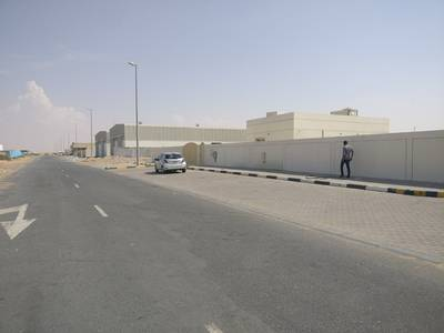 Industrial Land for Rent in Al Saja, Sharjah - 15000 sqft open yard only for storage 1 room boundary wall in Eic, new sajaa, sharjah