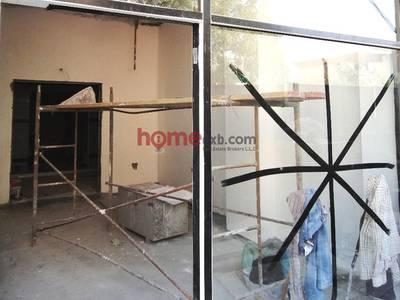 Shop for Rent in Al Hudaiba, Dubai - Retail Shop in Res Building