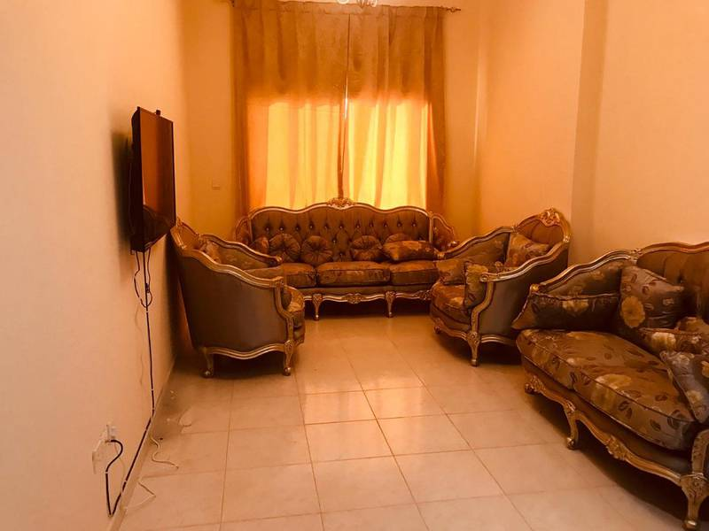 1 bed room & hall for rent in Emirates City Towers. 21000 With swimming pool and gym.