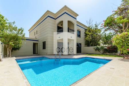 4 Bedroom Villa for Rent in Jumeirah, Dubai - Renovated | Pool and Garden | 13 Months