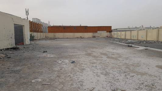 Industrial Land for Rent in Al Saja, Sharjah - 20000 sqft open yard office boundary wall concreted floor in sajaa sharjah