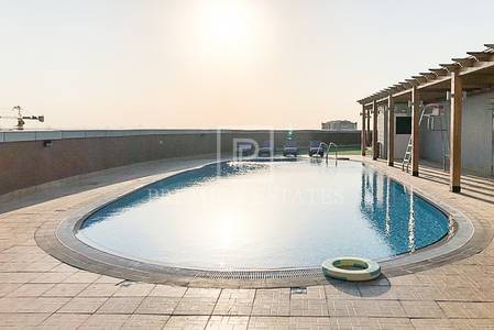 1 Bedroom Flat for Sale in Dubai Residence Complex, Dubai - Reduced! Spacious 1 Bed Apt  with Balcony