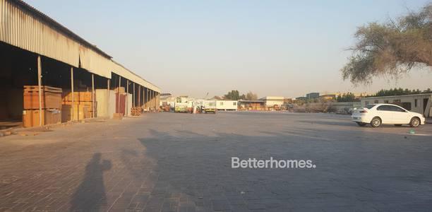 ارض تجارية  للايجار في راس الخور، دبي - Open yard with Shed & Office in Ras Al Khor