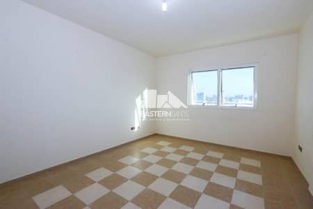 Building for Rent in Mohammed Bin Zayed City, Abu Dhabi - Living and Dining Area
