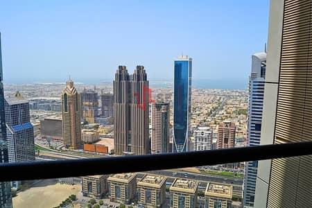 فلیٹ 2 غرفة نوم للبيع في مركز دبي المالي العالمي، دبي - Stunning Balcony view of DIFc & Sea