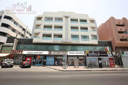 مکتب  للايجار في ديرة، دبي - Independent Commercial Office On Main Road At Prime Location of Al Muteena