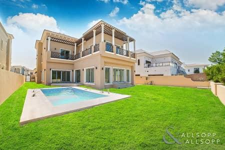 5 Bedroom Villa for Sale in Jumeirah Golf Estate, Dubai - Elevated Earth Course Views | Huge Plot