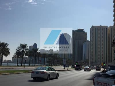 Building for Sale in Al Mamzar, Sharjah - BRAND NEW LUXURIOUS DUAL COMMERCIAL TOWER FOR SALE WITH VALUE ADDITION OF MOH APPROVAL