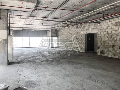 Showroom for Rent in Airport Street, Abu Dhabi - Brand New Core & Shell Showroom with Direct Access to Lifts! Airport Road
