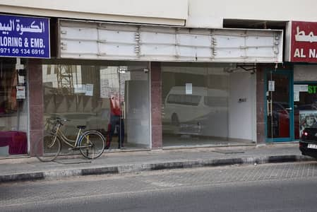 Shop for Rent in Al Nahda, Sharjah - محل باطلاله جانبيه ببنايه بالنهده خلف الانصار مول