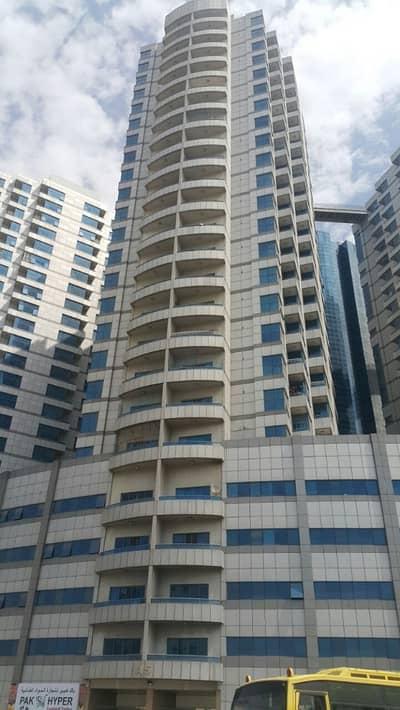 فلیٹ 2 غرفة نوم للايجار في عجمان وسط المدينة، عجمان - شقة في برج الصقر عجمان وسط المدينة 2 غرف 33000 درهم - 3743427