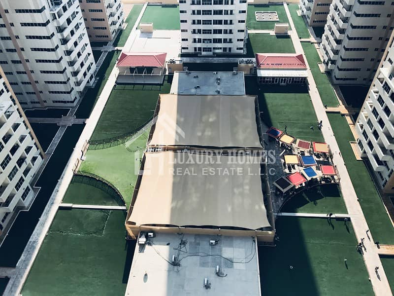Garden-View !! 2 BHK Flat having Closed-Kitchen in Ajman One Towers, Ajman