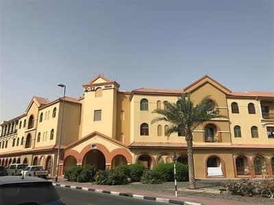 شقة 1 غرفة نوم للايجار في المدينة العالمية، دبي - شقة في طراز إسبانيا المدينة العالمية 1 غرف 33000 درهم - 3712962