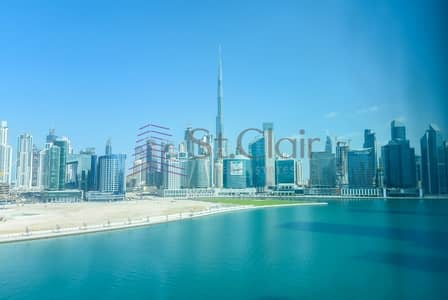 Office for Rent in Business Bay, Dubai - Canal and Burj Khalifa View | Partitioned