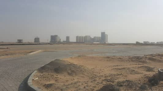 Plot for Sale in Al Raqaib, Ajman - Own your commercial land in Ajman by installments for 2 years