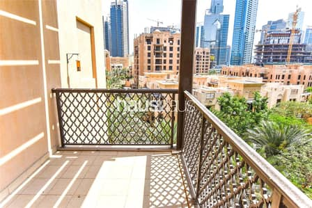 2 Bedroom Flat for Sale in Old Town, Dubai - Dining Area   Community Views   Tenanted