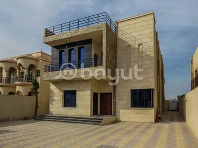 5 Bedroom Villa for Sale in Al Rawda, Ajman - Villa for sale the second part of the street finishing Super Deluxe