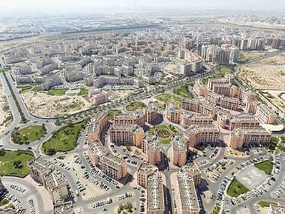 ارض تجارية  للبيع في المدينة العالمية، دبي - Commercial Plot with Retail in International City