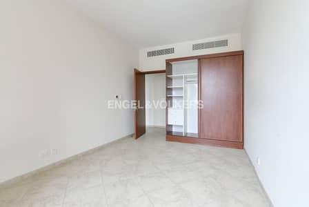 3 Bedroom Flat for Rent in Motor City, Dubai - Storage Room in Parking | Community View