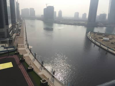 2 Bedroom Flat for Sale in Business Bay, Dubai - full canal view 2 bedroom bays edge tower waking distance Dubai mall