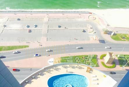 2 Bedroom Flat for Sale in Corniche Ajman, Ajman - HUGE FULLY SEA VIEW 2 BEDROOM  HALL  MAID ROOM  2 BALCONY FLAT FOR SALE IN CORNICHE TOWERS
