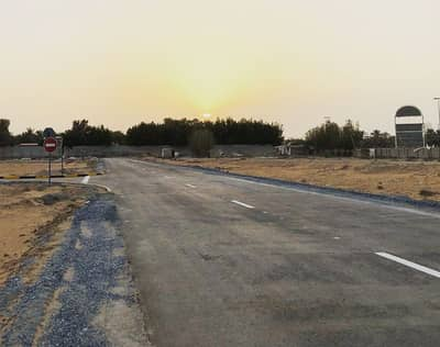 Plot for Sale in Al Ittihad Village, Ajman - For installment residential lands freehold for all nationalities , ground and 2 floors , streets