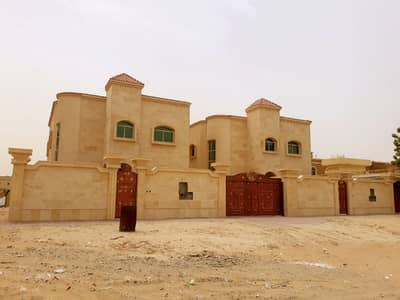 5 Bedroom Villa for Sale in Al Mowaihat, Ajman - vila for sale central air conditioning and in front of a mosque