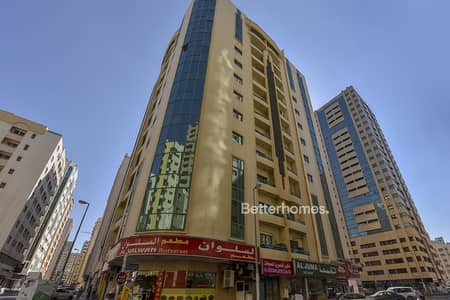 Building for Sale in Al Qasimia, Sharjah - G+12 Building | 96 Flats | 8 Shops | 11% ROI