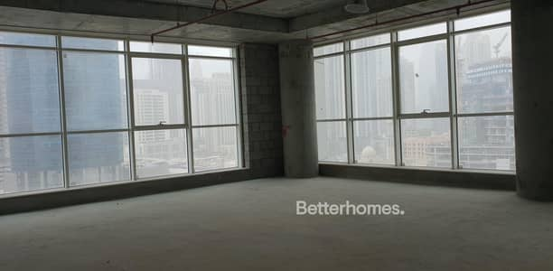 Office for Rent in Business Bay, Dubai - Below the market | Shell & core | Business Bay for rent
