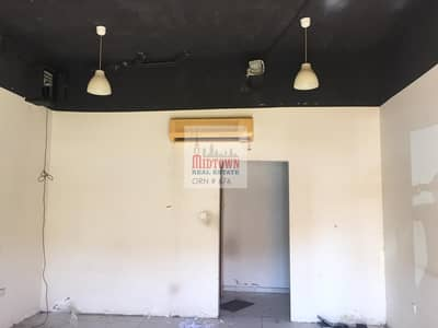 Shop for Rent in International City, Dubai - low price small shop for rent in france 463 sqft only 22600