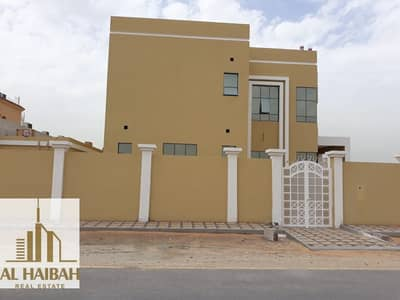 5 Bedroom Villa for Sale in Hoshi, Sharjah - For sale a new two-story villa with a corner of two streets with an extension