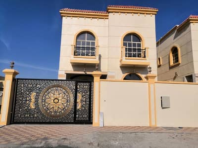 5 Bedroom Villa for Sale in Al Mowaihat, Ajman - New villa facing stone, good price and excellent location with the possibility of bank financing