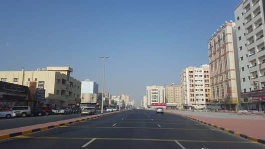 AL NUAIMIYAH AREA, ON AL KUWAITI STREET, OPPOSITE NUAIMIYA TOWERS BUILDING FOR SALE