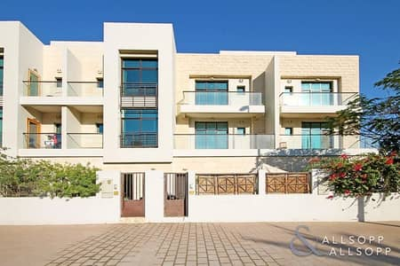 4 Bedroom Townhouse for Sale in Jumeirah Village Circle (JVC), Dubai - 4 Beds + Maids | Shared Pool & Gym | VOT