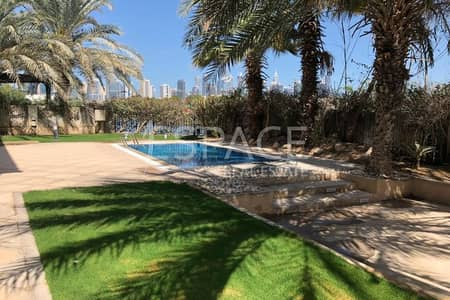 4 Bedroom Villa for Rent in Jumeirah Islands, Dubai - Lake And Skyline View - Vacant - Upgraded