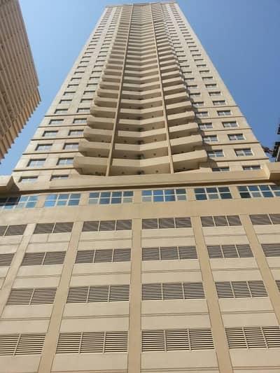 شقة 1 غرفة نوم للبيع في مدينة الإمارات، عجمان - شقة في برج الزنبق مدينة الإمارات 1 غرف 180000 درهم - 3907648