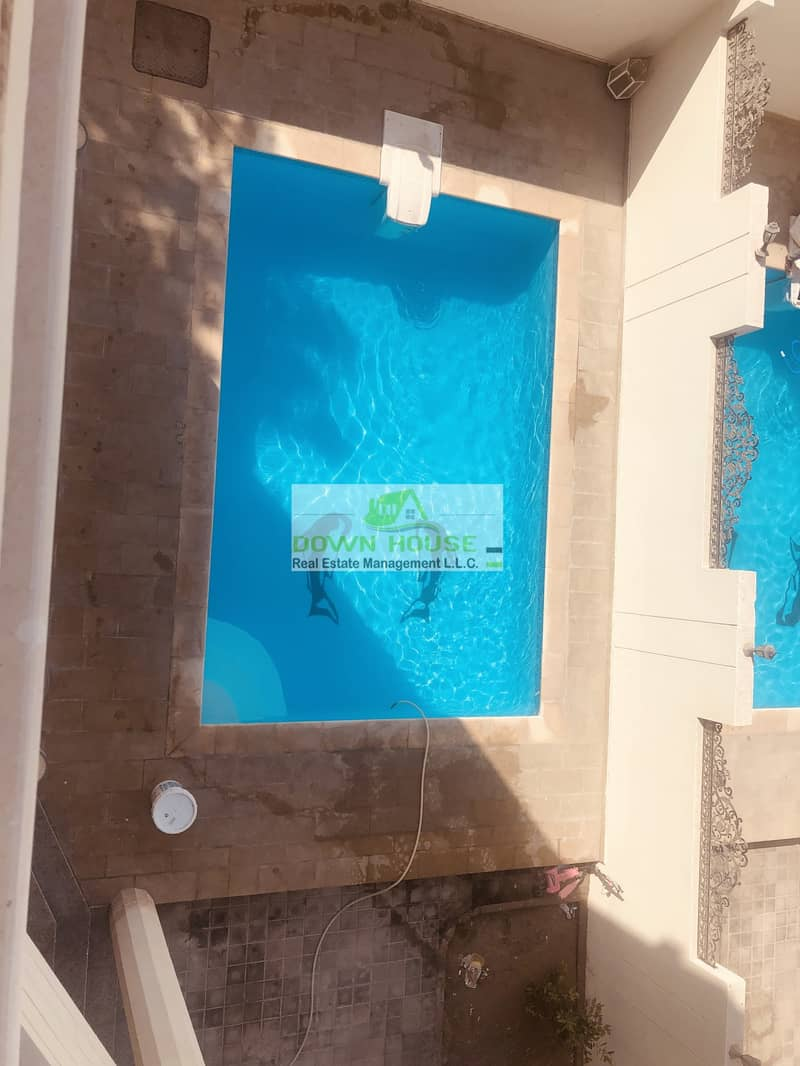 15 New huge 1- bedroom hall in khalifa city A . Shared swimming pool