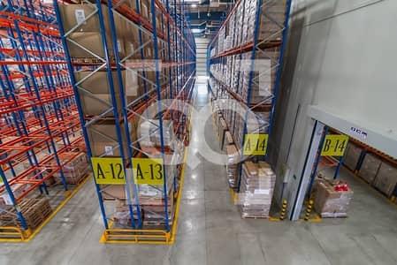 مستودع  للبيع في دبي وورلد سنترال، دبي - Top Quality Warehouse with Racks for Logistics in DWC Dubai