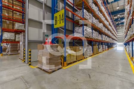 Warehouse for Rent in Dubai World Central, Dubai - Quality Warehouse with Racks for Logistics in DWC Dubai