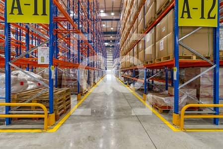 Warehouse for Rent in Dubai World Central, Dubai - Top Quality Warehouse with Racks for Logistics in DWC Dubai