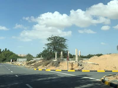 Plot for Sale in Al Ittihad Village, Ajman - Residential land corner two street ground and two floors approved , freehold
