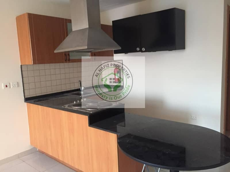 2 studio for sale in DSO silicon oasis spring oasis building  vacant on transfer with balcony