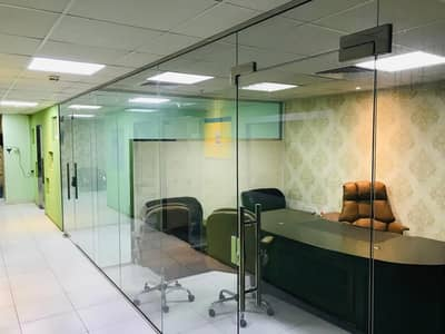 Office for Rent in Al Rashidiya, Ajman - HUGE OFFICE WITH PARTITIONS, WITH FURNITURE