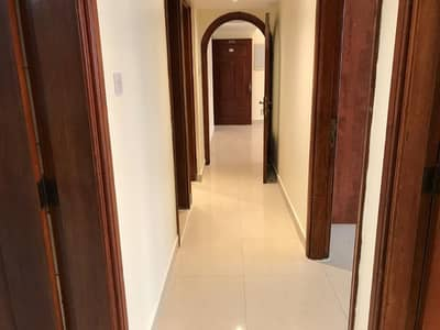 2 Bedroom Apartment for Rent in Airport Street, Abu Dhabi - Big And Neat 02 Bedroom Hall Central AC For 60k Walking Distance Near Sheikh Khalifa Medical City