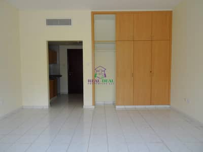 Studio for Rent in International City, Dubai - Ground floor studio for rent at Italy Cluster